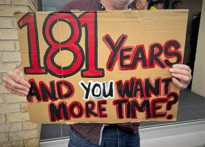 '181 years and you want more time' protest sign